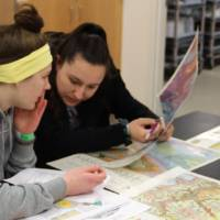 Students working on maps